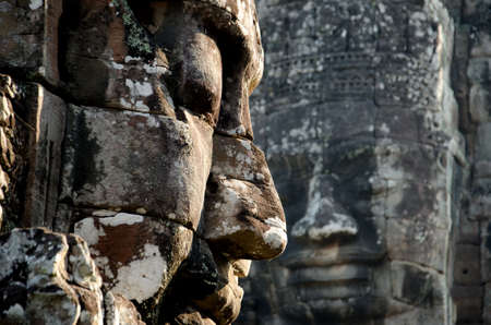 angkor thom: Two faces from Bayon the Heart of the Capital Angkor Thom