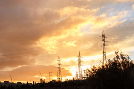 Electricity pylon at sunset with a dramatic sky. Imagens