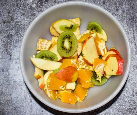 Fresh fruit salad in bowl, top view Stock fotó