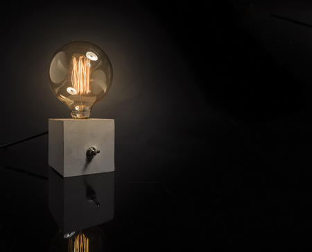 modern lamp with retro lamp and made with concrete Imagens