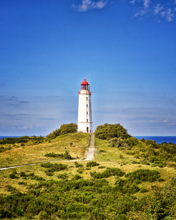 Classic view of the famous Lighthouse Dornbusch on the beautiful island Hiddensee in summer, Baltic Sea, Mecklenburg-Vorpommern, Germany