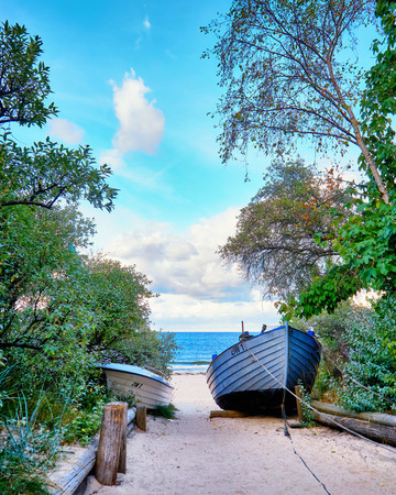 Fishing boat on the way to the beach to the Baltic Sea. Zinnowitz on the island of Usedom. Standard-Bild - 114117530