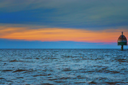 Dive gondola in the Baltic Sea with colorful sunset in the background. Standard-Bild - 114117539