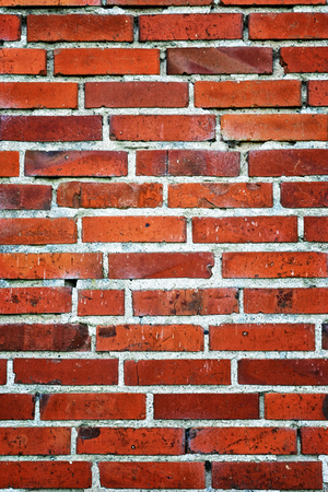 Brick wall background vertical with holes. 免版税图像