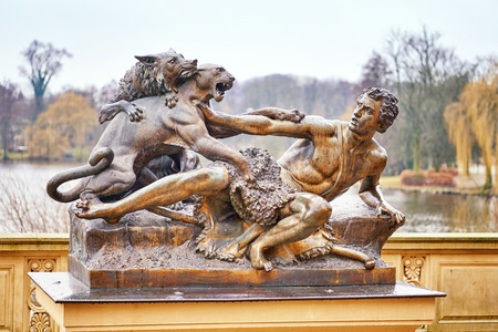 Shepherd and dog attacked by a panther. Sculpture in Schwerin Mecklenburg-Vorpommern. Фото со стока