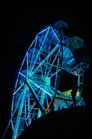 Ferris wheel at night with blue light. Stok Fotoğraf - 124858878