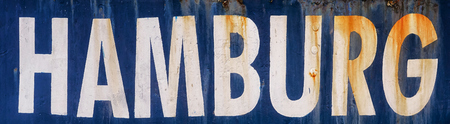 Hamburg in white capital letters as text on blue background. Stock Photo