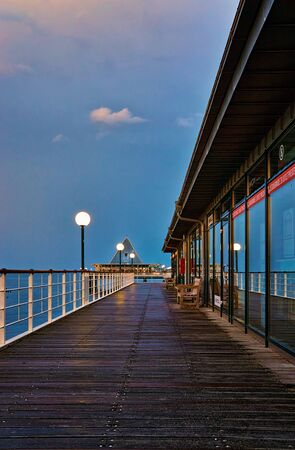 Wooden path on the pier in Heringsdorf in the evening. Baltic Sea island Usedom. Germany