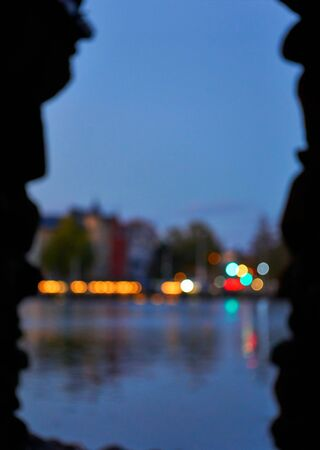 Blurred colorful lights of the night city in the background.