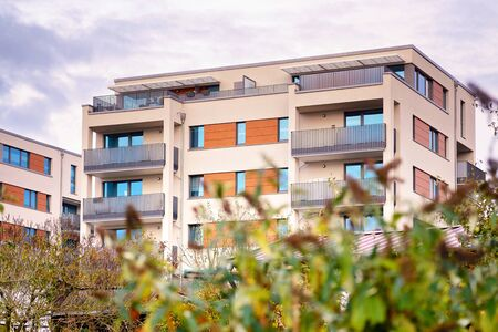 Modern residential building with outdoor facilities in Schwerin. Facade of new low-energy houses.