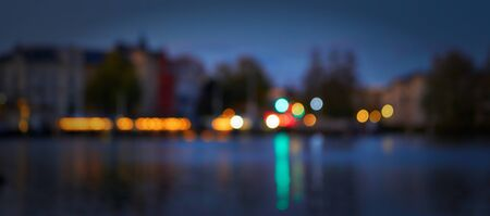 Panorama of blurred colorful lights of the night city in the background.