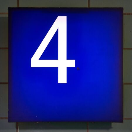 Number 4 in white on a blue background.