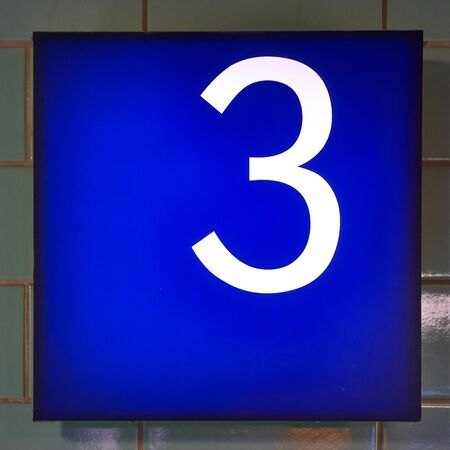 Number 3 in white on a blue background.