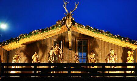Nativity scene on a wooden house at the Christmas market .. Reklamní fotografie