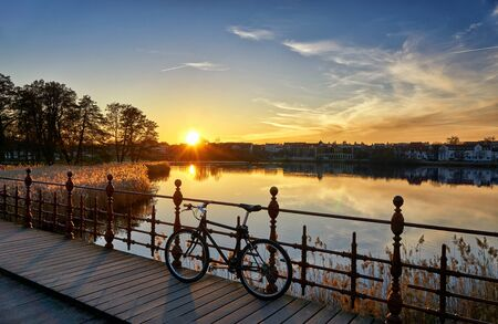 Beautiful sunset at a bridge with a bicycle.