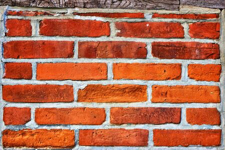 Old red brick wall as a background.