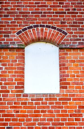 White window with place for text on a brick wall.