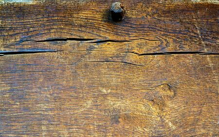 Wooden beams with cracks as a natural background. Stockfoto
