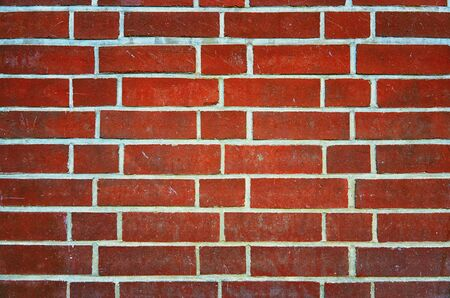 Old dark red brick wall as a background. 版權商用圖片