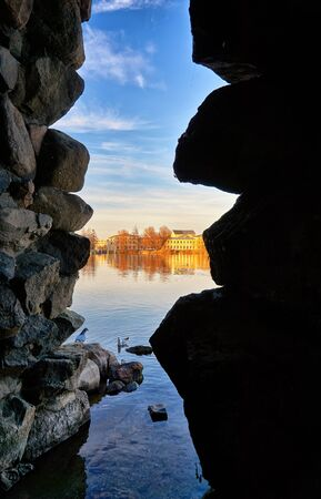 View through a grotto to the Marstall building on Lake Schwerin. Mecklenburg-Vorpommern, Germany