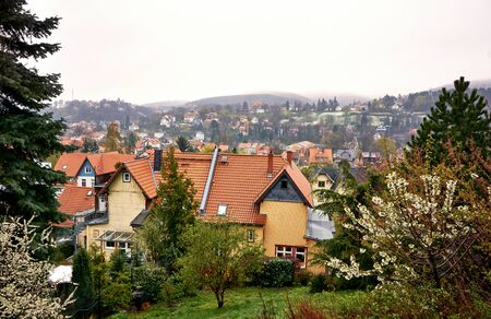 View over the historic half-timbered houses on the town of Wernigerode in the fog. Saxony-Anhalt, Germany