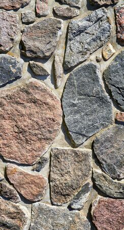 Medieval stone wall as a vertical background. 版權商用圖片