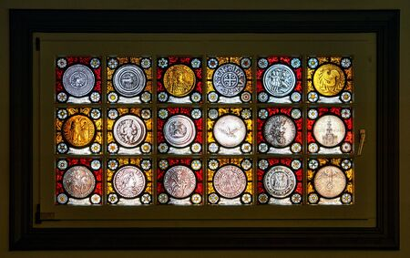 Old historical german coins pictured on a window. 版權商用圖片
