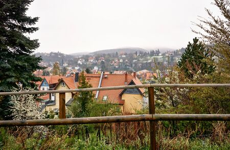 View over the roofs of the city Wernigerode in the fog. Saxony-Anhalt, Germany
