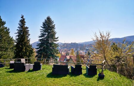 Seating group overlooking the rooftops of the city Wernigerode. Saxony-Anhalt, Germany 版權商用圖片
