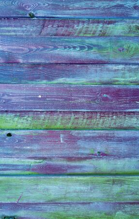 Wooden background with colorful wood grain.