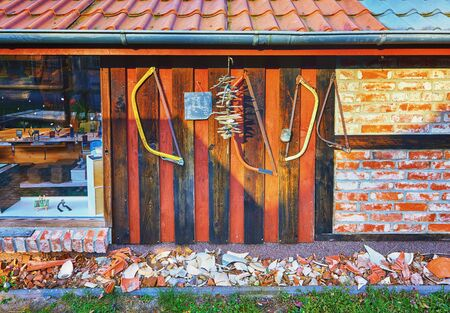 Half-timbered house with old blessing as decoration.