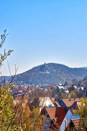Above the rooftops of Wernigerode with the castle in the background. Saxony-Anhalt, Harz, Germany