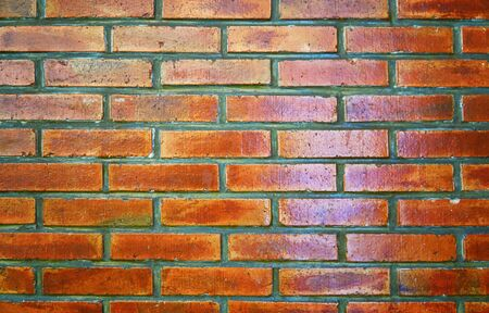 Shiny red brown brick wall background.