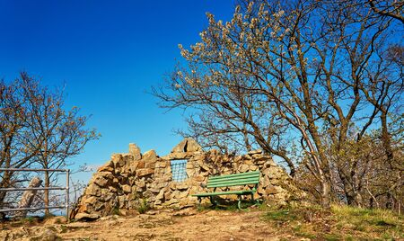 Bench in front of stone wall on the witch dance place in Thale. Saxony-Anhalt, Harz, Germany