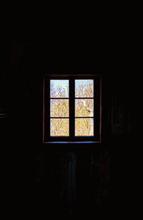 Bright window on dark background.