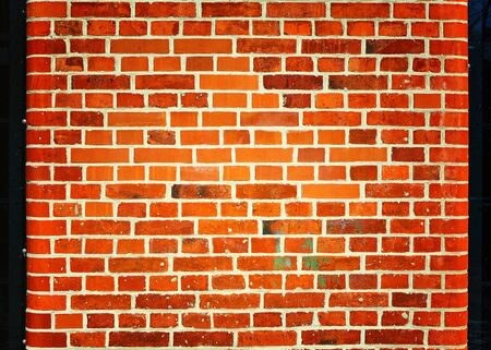 Brick wall with rounded edges as background.