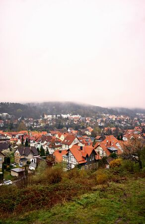 Historic half-timbered houses of the city of Wernigerode in the fog. Saxony-Anhalt, Germany 版權商用圖片
