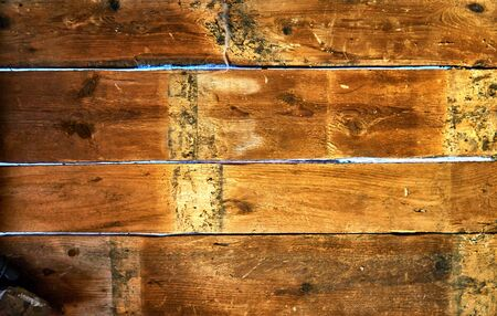Wooden background with light between the split. With space for your text.