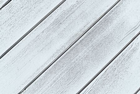 White natural wood background with rough structure.