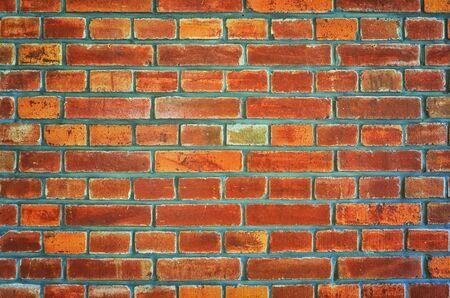 Indoor brick wall background in reddish brown.