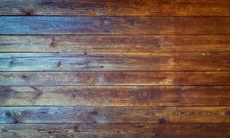Old wood background with flowing colors.