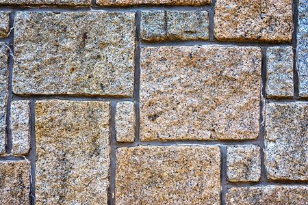 Background from paving stones. Irregular natural stones. Фото со стока