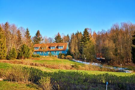 House between many trees in the forest in Elbingerode. Germany