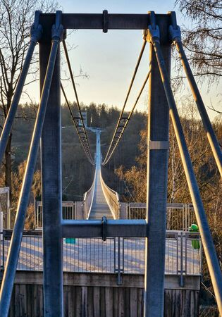 Along the Titan RT bridge on Rappbode-Dam. The longest pedestrian suspension bridge in the world in the Rappbodetalsperre. Saxony-Anhalt, Germany Фото со стока