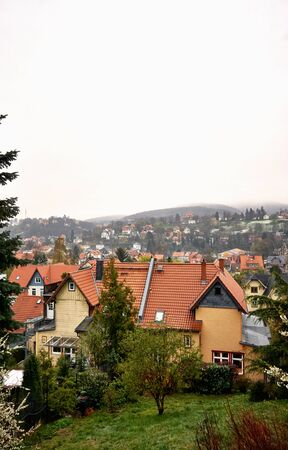 Roofs of old houses in the city of Wernigerode with fog over the mountains. Saxony-Anhalt, Germany