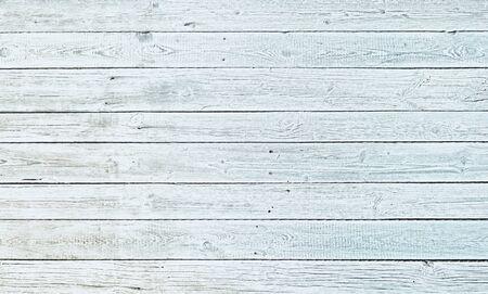 Old light white wooden background.