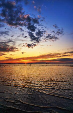 Beautiful sunset in Swinoujscie on the Baltic Sea beach. Swinoujscie, Poland