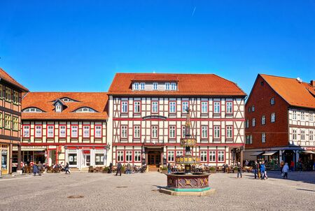 Fountain on the market square with old half-timbered houses in the old town of Wernigerode. Saxony-Anhalt, Germany