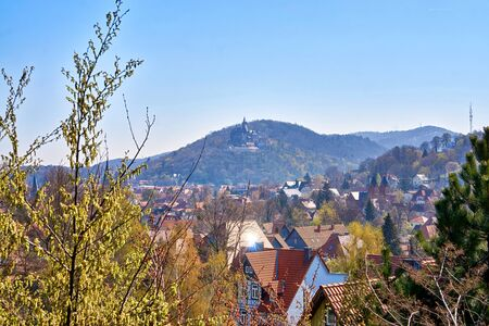 Above the roofs of Wernigerode with a castle in the mountains in the background. Saxony-Anhalt, Harz, Germany