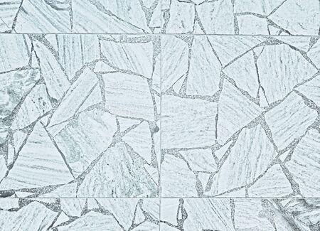 Natural slate paving as a white background. Фото со стока